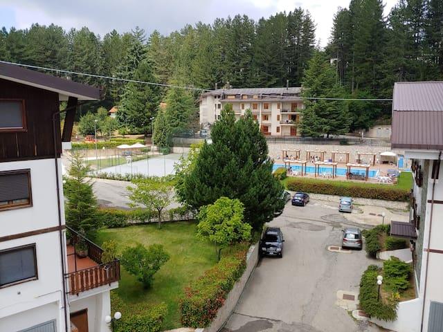 Mansarda a Camigliatello con piscina e campetto