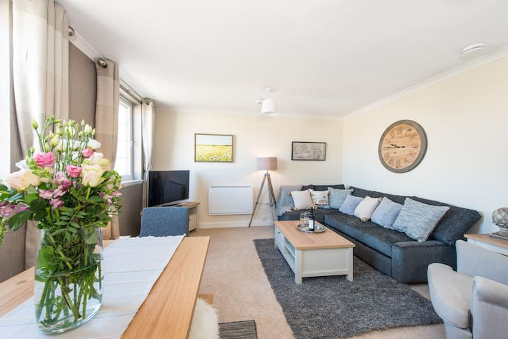 The Living Room has a comfortable sofa on which to watch TV and a dining table