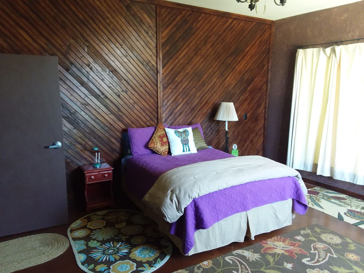 The large bedroom has a comfortable queen-sized bed and super-sized windows for sunset and storm viewing.