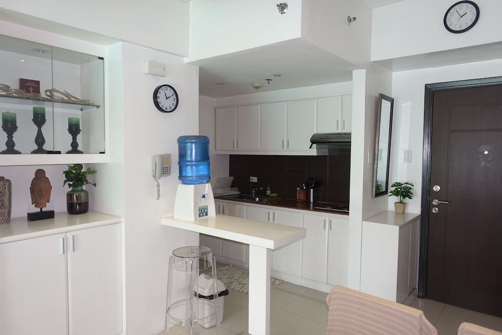 Kitchen equipped with fridge, microwave oven, rice cooker and other stuff in this spacious pantry