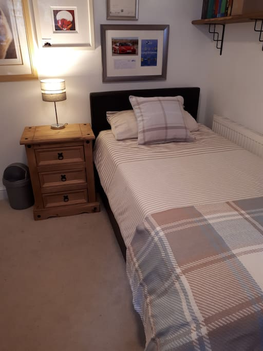 bed was originally in this position but we have moved the room around and it's as shown in the other photos.
