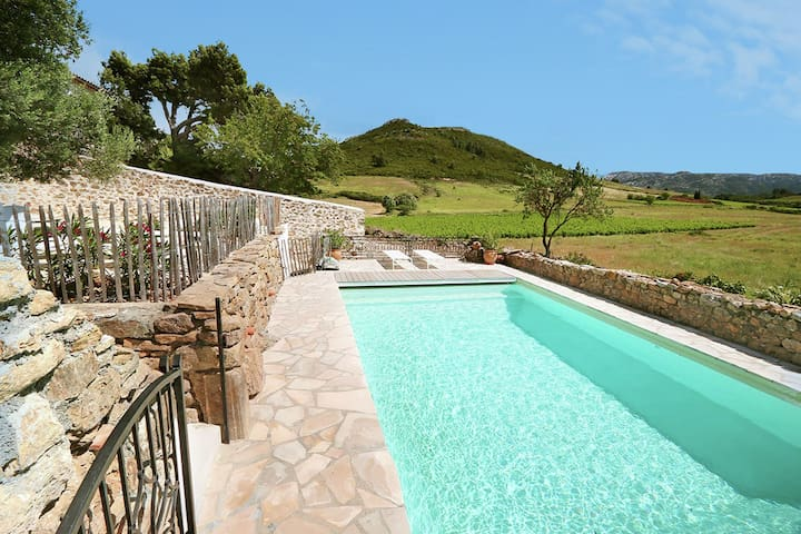 Luxury air-conditioned gîte in wine farm with heated pool and stunning views