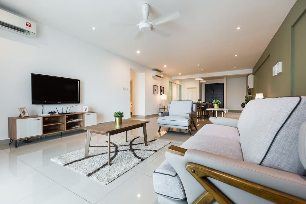 The spacious living area where you can enjoy the tv and watch the perfect seaview.