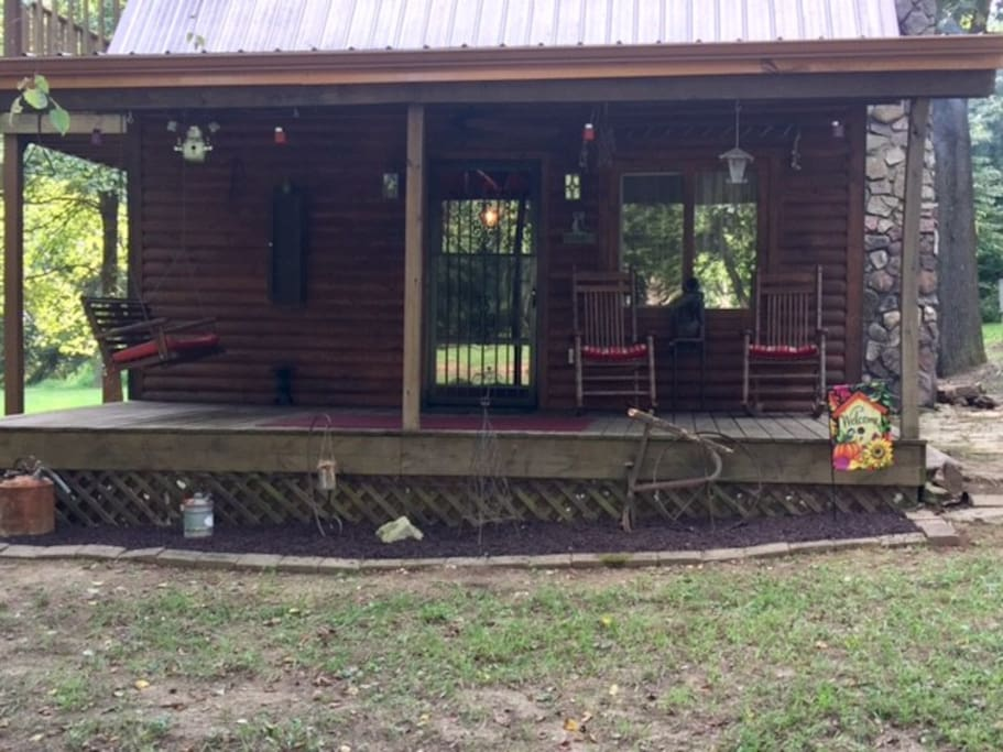 Front porch of the cabin w/ swing and rockers