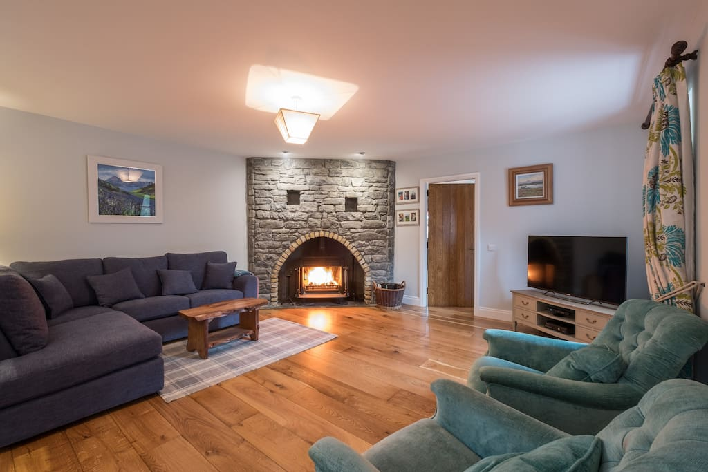 Large and cosy lounge with real fire, top of the range internet TV & XBOX with netflix etc, corner sofa and armchairs.