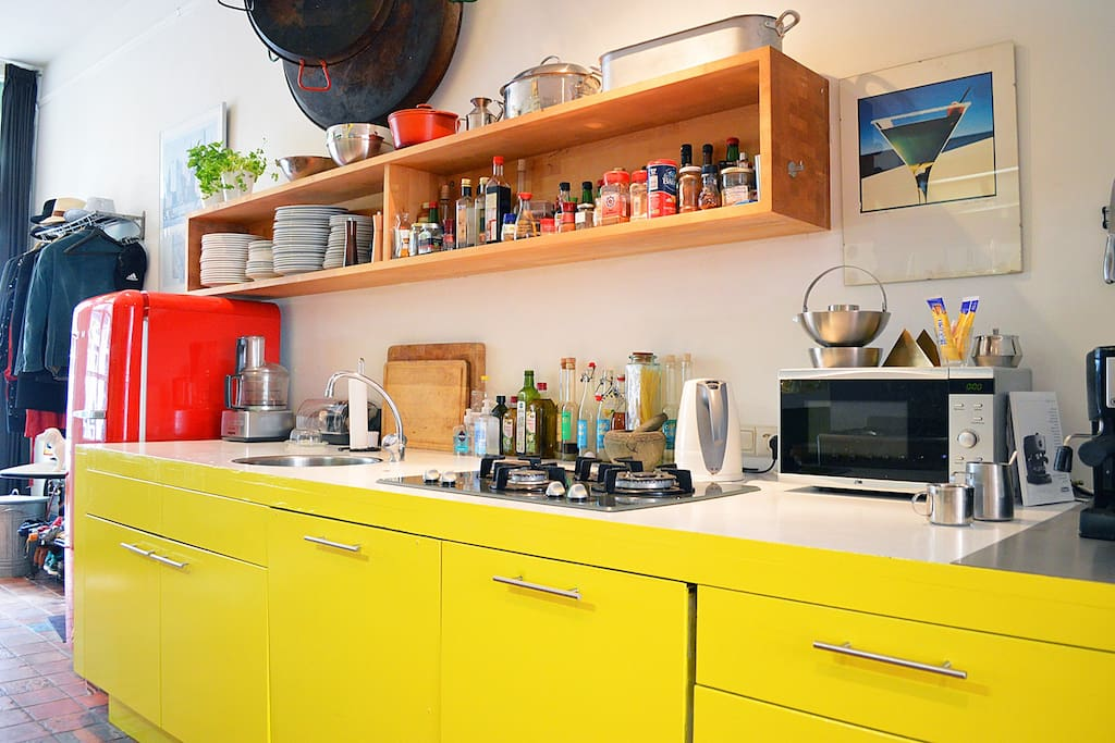 The kitchen comes in the lively color yellow