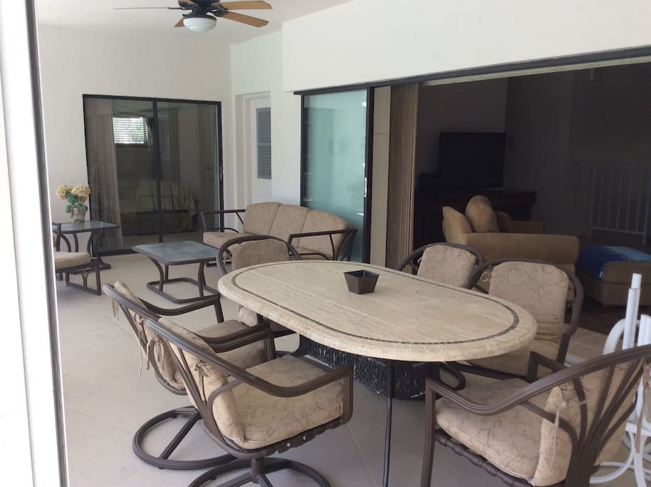 Enjoy meals on the roomy covered Lanai. Open the pocket sliding doors in the Great Room to bring the outside in & the inside out.
