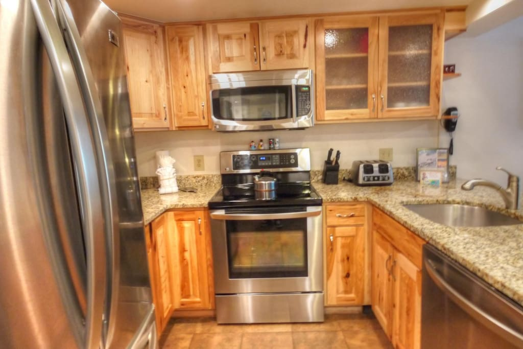 Kitchen  - The newly remodeled kitchen features granite counters and stainless steel appliances.