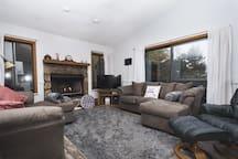 Spacious living room with 2 lounging couches and gas logs