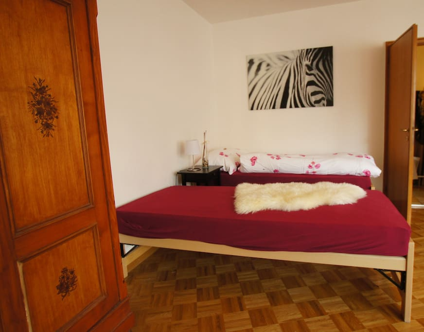The bedroom consists of two single beds and one sofa-bed.