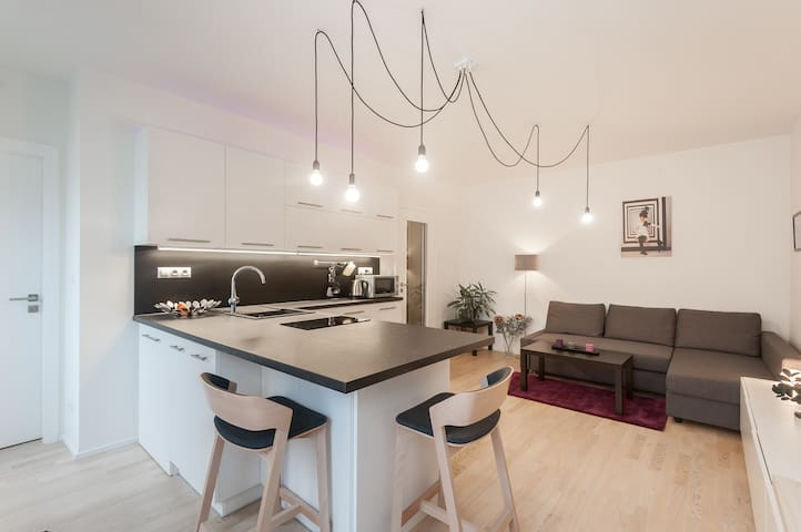 Modern flat in the center-private parking included