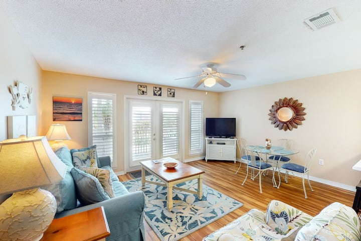 Bright, open 3rd-floor condo w/ pool views from private balcony + next to beach!