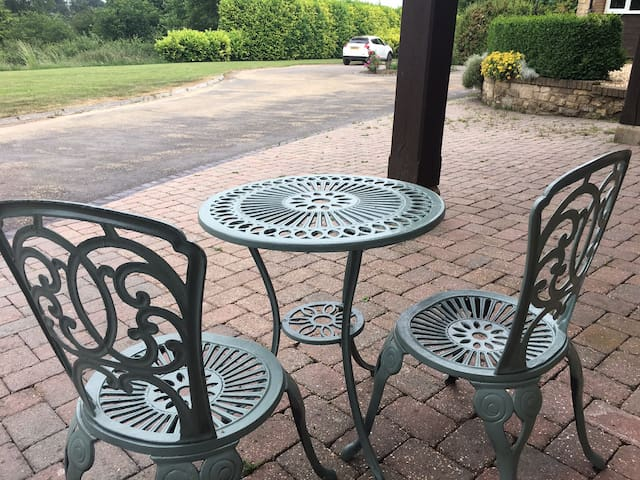 Bistro seating for guests for glass of wine in the sun or a smoke
