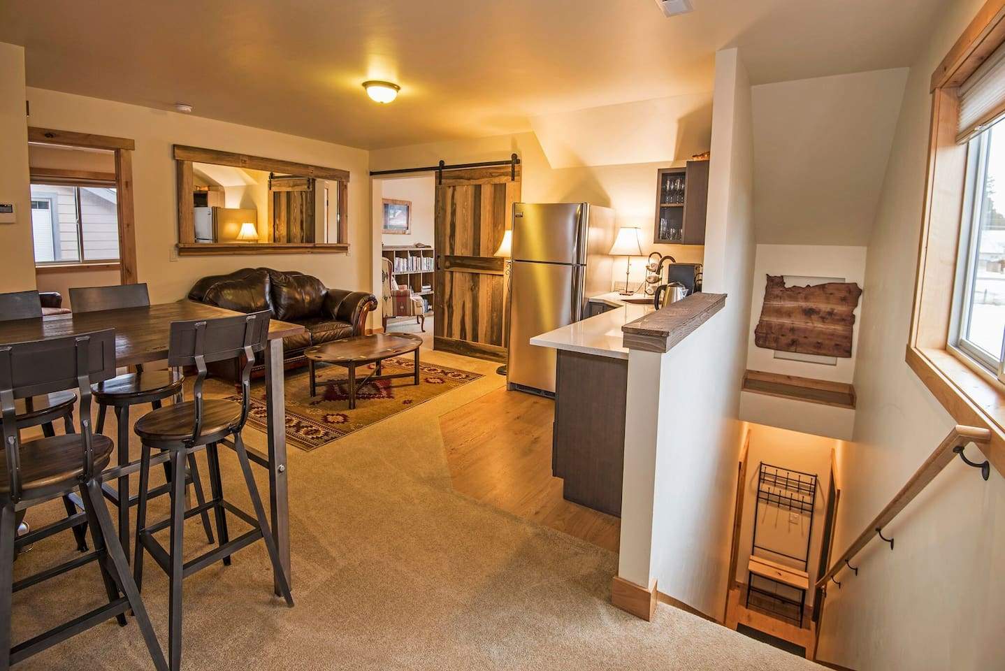 Panoramic view of the entry way and living room.  All guests enjoy complimentary Sisters Coffe Co. Coffee