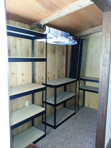 Large Walk in Closet Area with Shelf for Suitcases