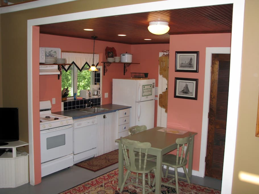 Kitchen leads to Deck with dining