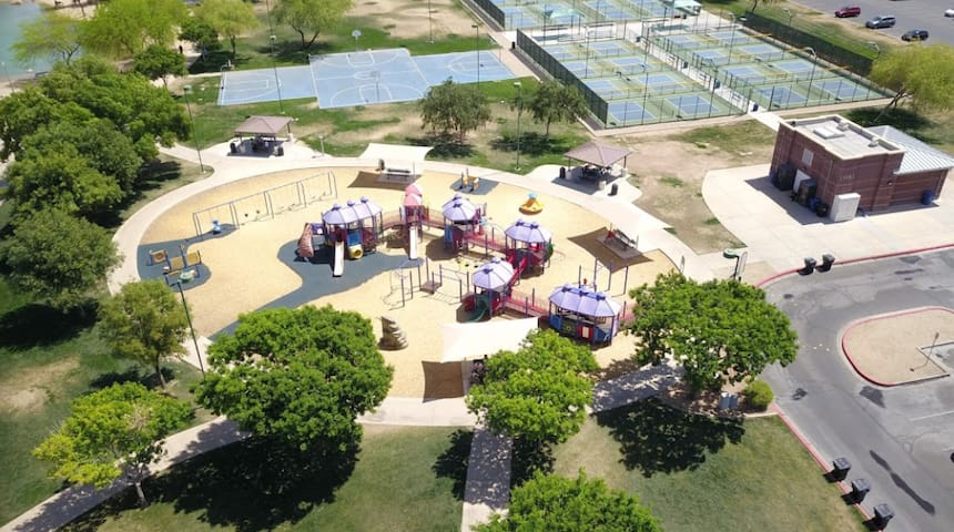 10 Min Walk to Surprise Community Park. Kids play area, Fishing, Volleyball, Basketball, Tennis Court, Pickle ball.