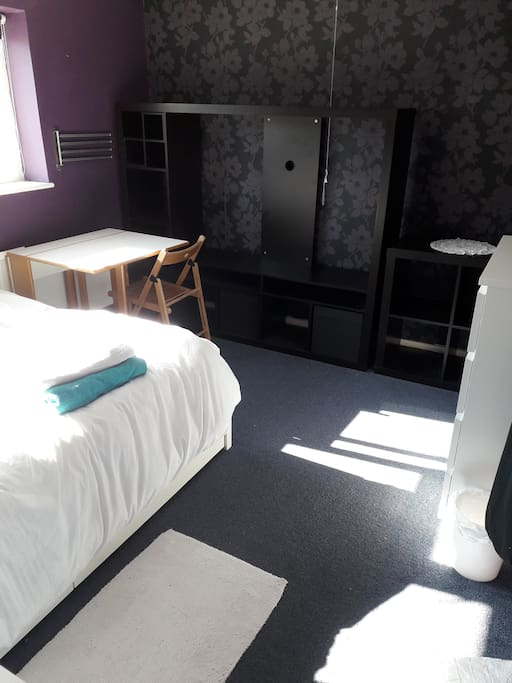 Large upstairs room with double bed, chest of drawers table chairs. Tea/coffee facilities. Plenty of cupboard space. Hairdryer,laundry service(£5 per wash load (washed and dried £10 if ironed) Towel rail,bedside table with lamp and fan unit if required. Towels, wall chart with pins.