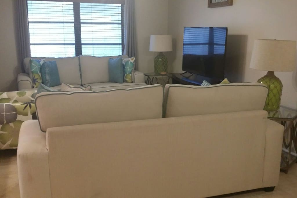 """Living room with 60"""" TV w/cable"""