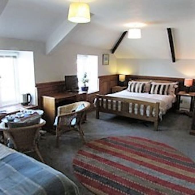 The room is large with a king size bed and a single bed. Stunning views over the harbour.
