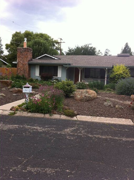 Fully landscaped, charming exterior.