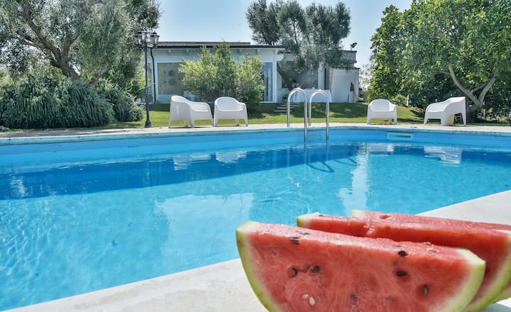 """Traditional Homes """"Trulli Oasi di Odisseo"""" with Pool, Terraces, Garden, Wi-Fi & Air Conditioning; Parking Available"""
