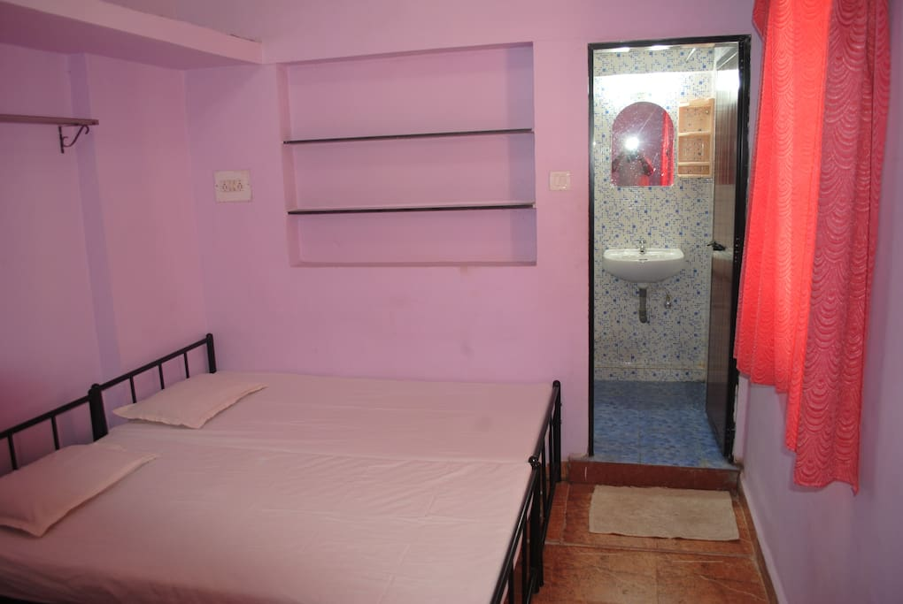 AC bedroom3 with 4 single beds and attached bathroom
