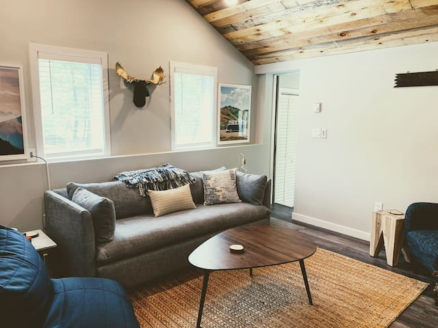 Gather in the comfortable family room for games or a good movie by the fireplace. This room has a memory foam queen sofa bed to serve as an additional private bedroom.