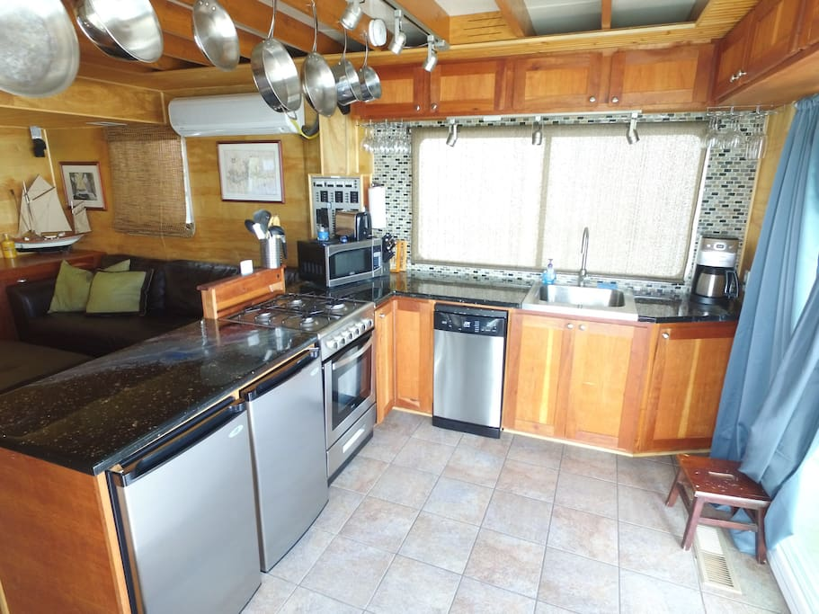 Compact kitchen with cherry cabinets