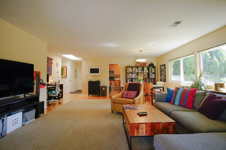 "Living room, featuring 65"" tv + Apple TV"
