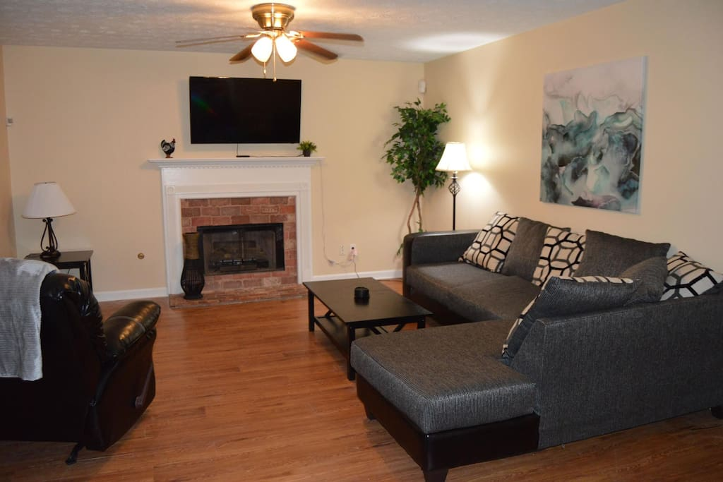 Comfortable living room with fireplace and flat screen TV,