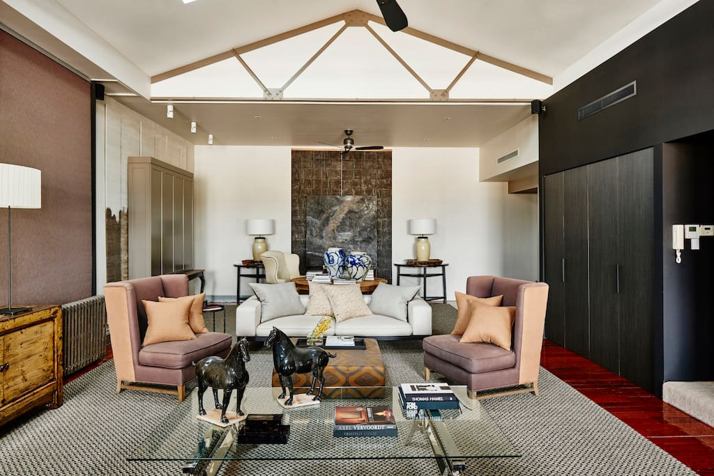 You'll love the huge living room with several couches