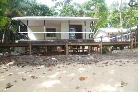 Beachfront bungalows on private lagoon island