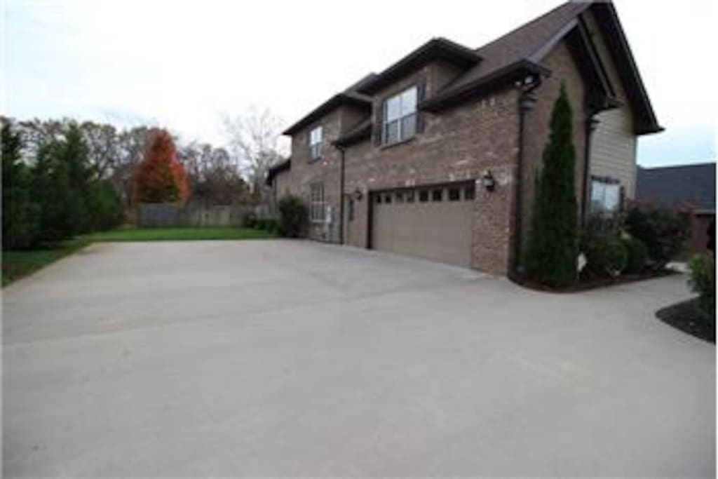 Ample parking for guests in a private well-lit driveway.