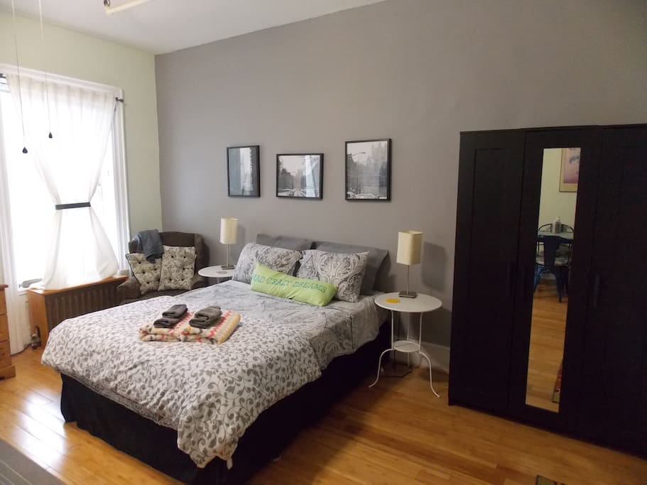 Comfortable queen sized bed, one of two large windows and a large closet.