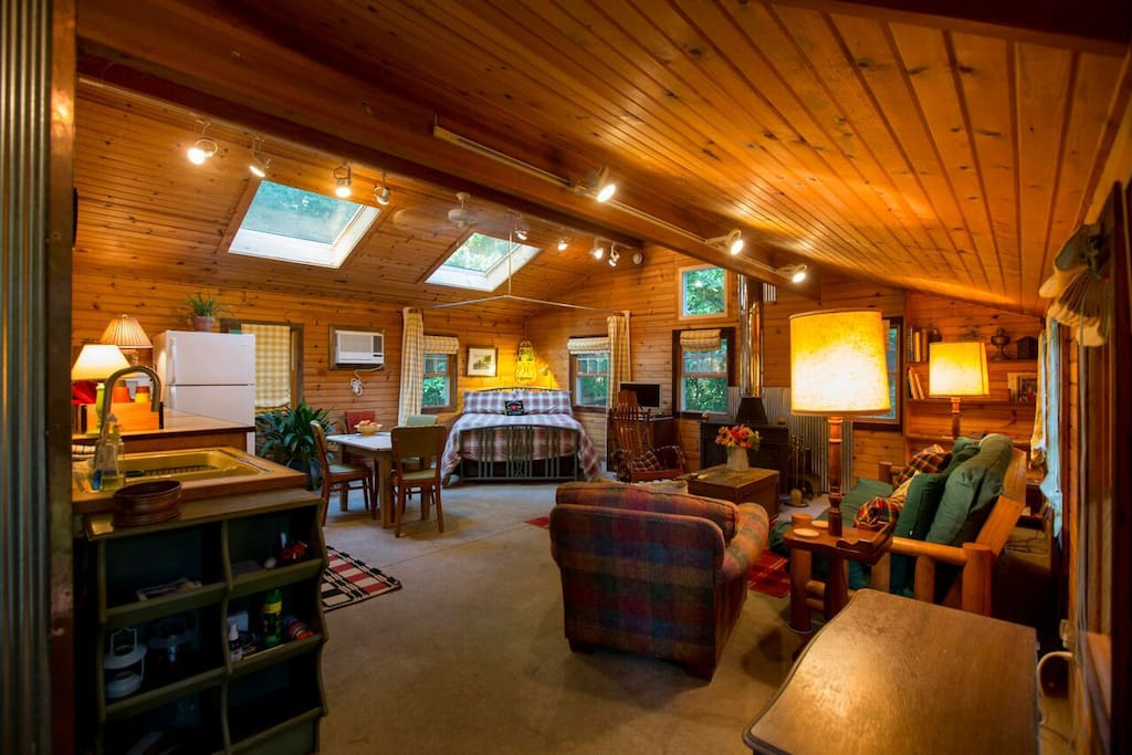 Skylights and homey living area welcomes you to McComb's Cabin
