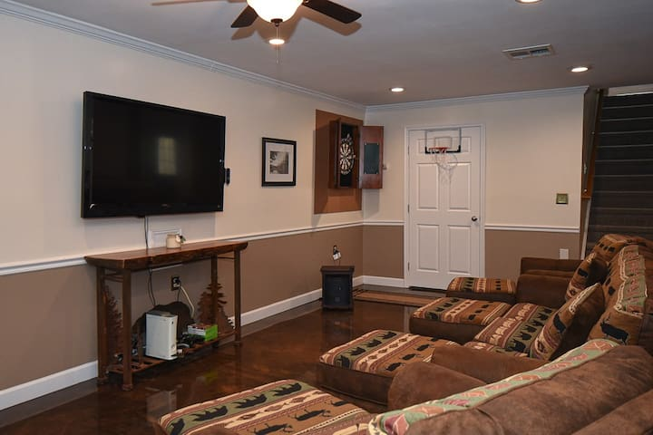 TV w/ Roku and gaming console. Newly remodeled half bathroom located in this area.