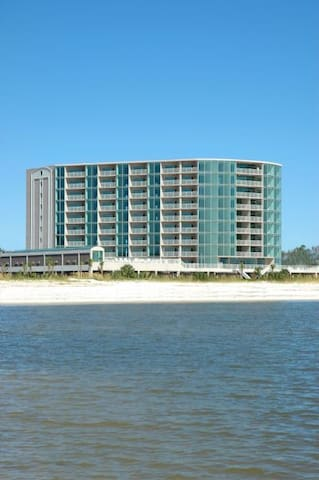 View of condo building from water.