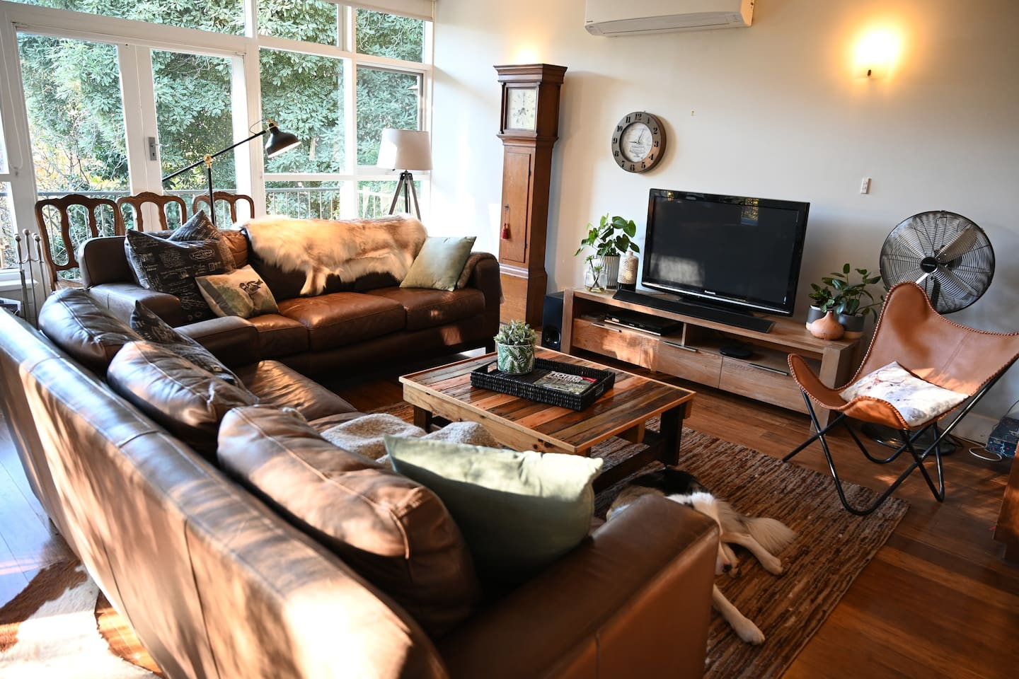 The cosy living room has deep comfy leather sofas to watch the TV/Telstra box/DVDs from