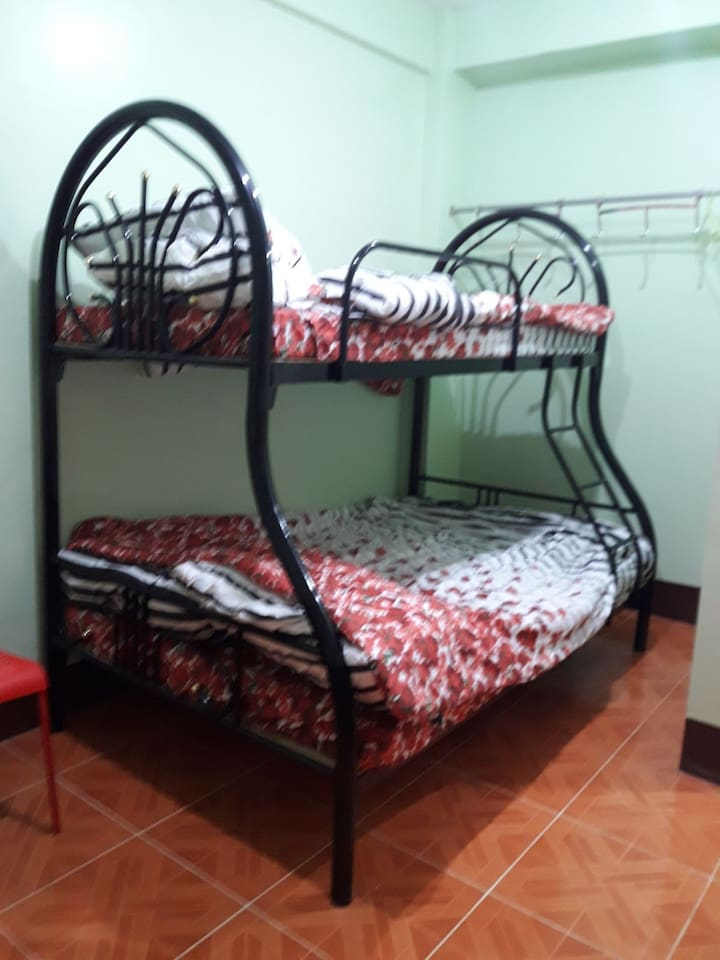 This is the bunk bed in the bedroom which consist of a double bed and a single bed on top. Three persons could be accommodated in this room preferably a family.