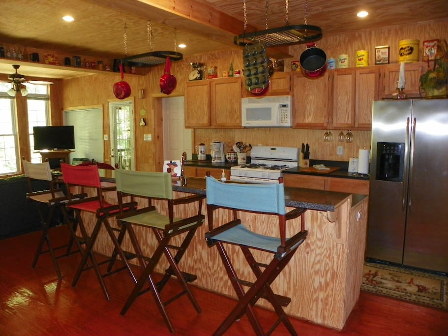 Full kitchen, bar for entertaining or supervising the cook!