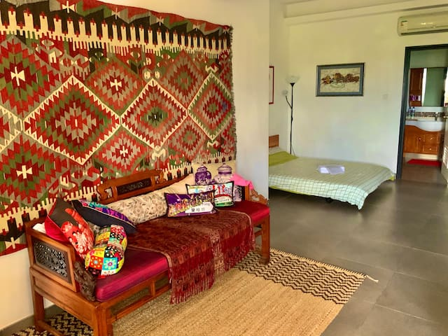 The ground floor guest room, decorated in Oriental style.