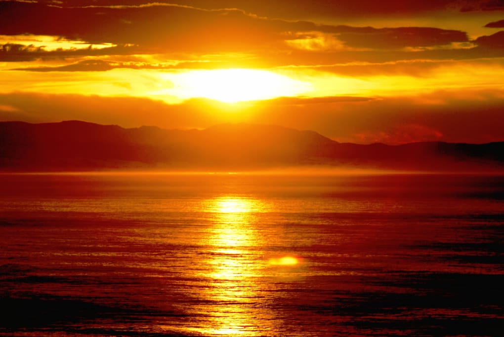 Awake to the sound of the sea and the spectacular sight of a golden ocean sunrise from the cozy comfort of your bed.