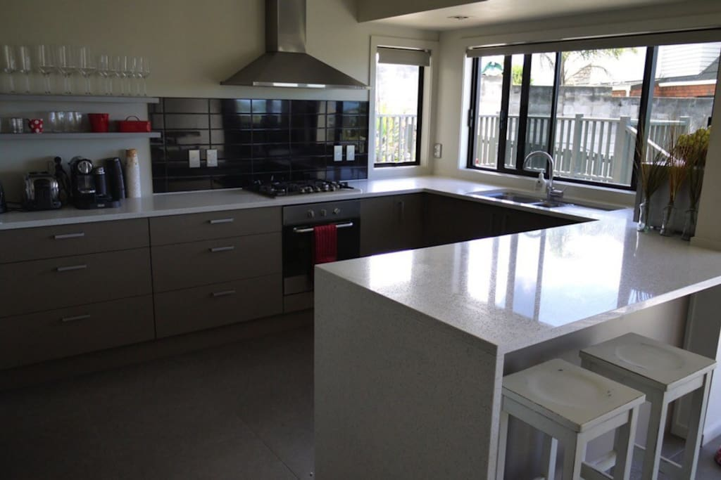 Open plan modern kitchen with gas hob