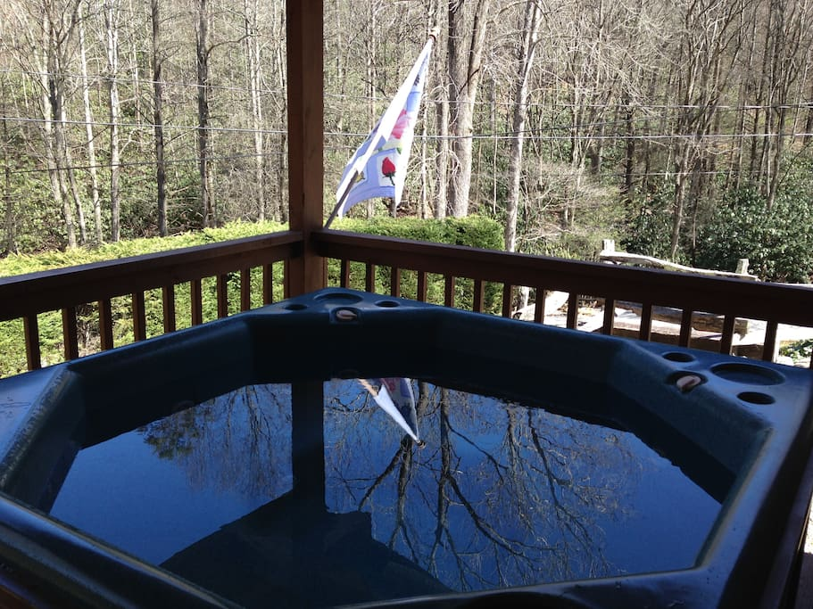 Large hot tub on covered deck, right off the living room.