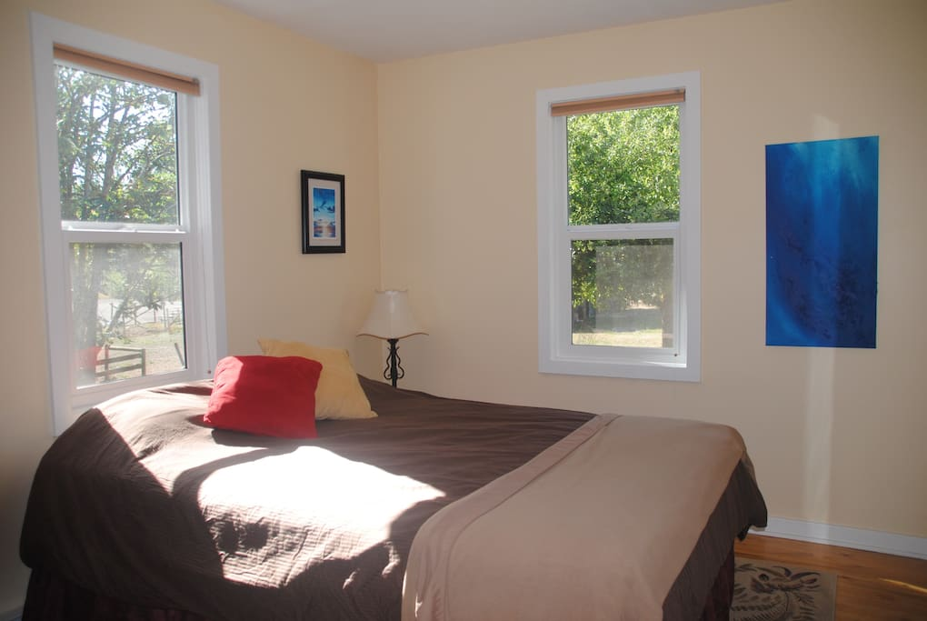 Bright sunny bedroom with apple tree view