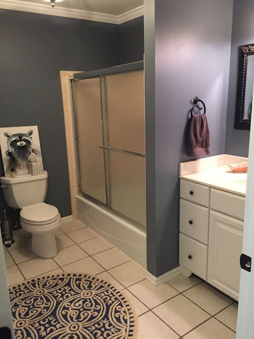 Full bathroom with tub/shower. Laundry room is also in here.