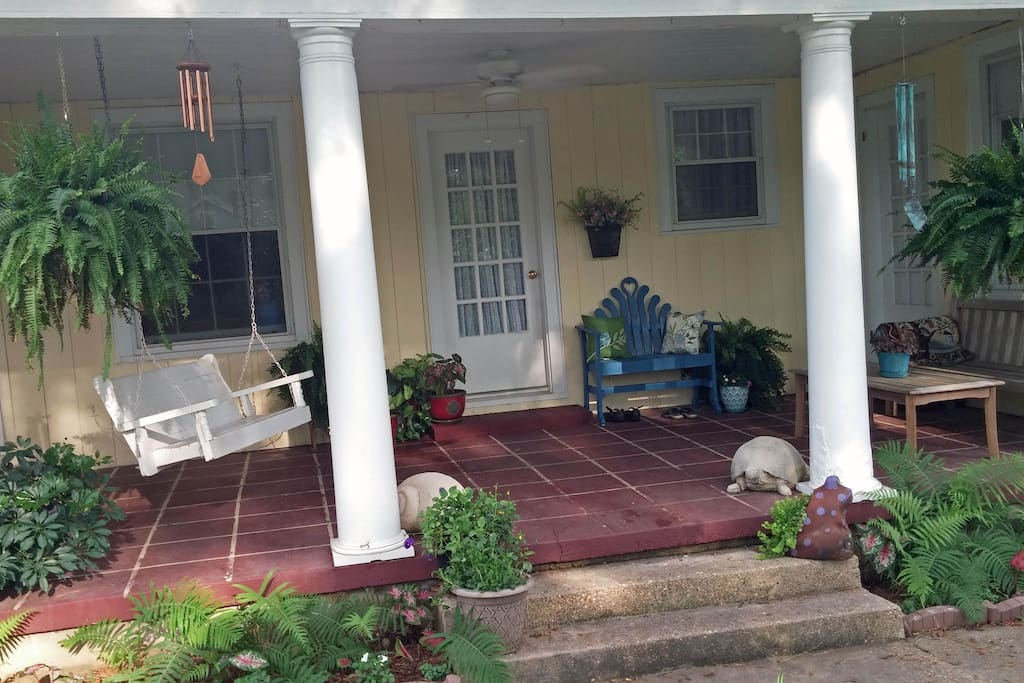 You'll have private access to your room off this shady porch.  Feel free to sit on the swing and watch the cardinals or prop on the bench with a good book and morning coffee.