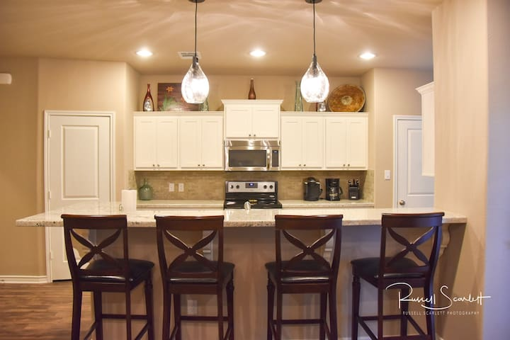 Lots of space to eat in the kitchen whether cooking or takeout or delivery.