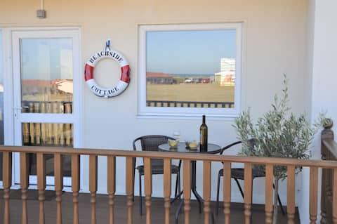 Cabaña junto a la playa con vistas al mar y WiFi gratuita